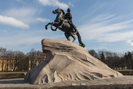 The bronze horseman monument illuminated by the evening sun in Saint-Petersburg.