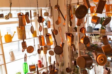 kitchen utensils hanging Stock Photo