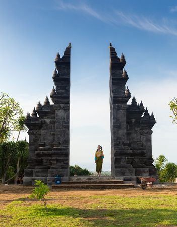 Girl is standing in the gate of Pura Lempuyang temple on Bali island, Indonesia Stock Photo