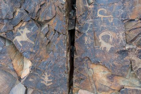 the ancients Petroglyphs in Tamgaly Tash in Kazakhstan Archivio Fotografico - 116175925