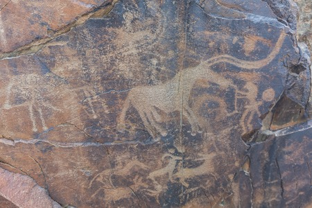 the ancients Petroglyphs in Tamgaly Tash in Kazakhstan Archivio Fotografico - 116175931