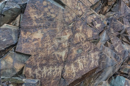 the ancients Petroglyphs in Tamgaly Tash in Kazakhstan Archivio Fotografico - 116175475