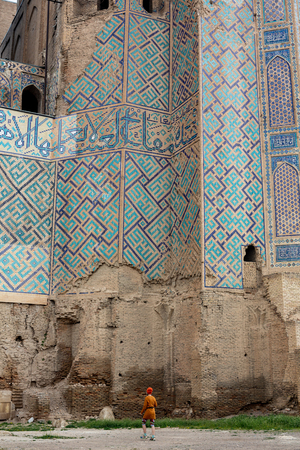 Symmetrical decorative ornament of entrance to the tomb and open door in Shah-I-Zinda, a memorial complex, necropolis in Samarkand, Uzbekistan