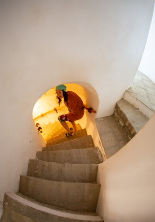 Teen girl walking up the stairs discovering new secrets Stockfoto