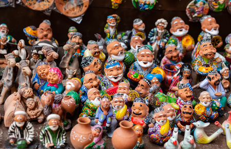 the showcase with Uzbek Souvenirs, ceramic figurines of people.