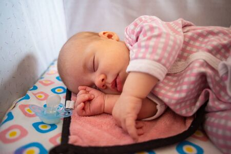 close-up portrait of a beautiful sleeping baby.