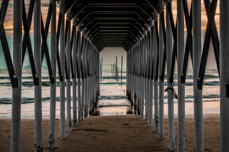 Perspective view from inside of an under construction wooden architecture of a ferry terminal for ferry passengers
