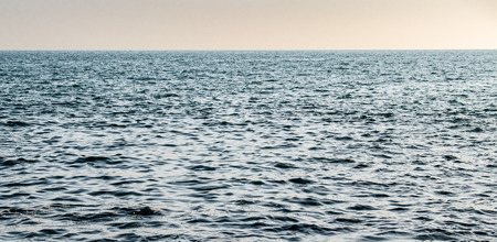 Calm and Blue ocean in High Seas with clear visible horizon and no landmass. Photograph taken in Arabian Sea in Indian territorial waters, while travelling for fishing to a distant island.