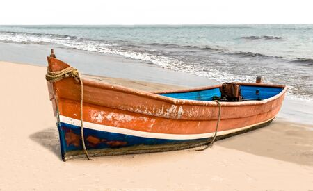 Beautiful beached Canoe, painted colorful in traditional Asian colors, this Canoe is powered by generator and is used by local fishermen for fishing in high seas, currently idle due to offseason.