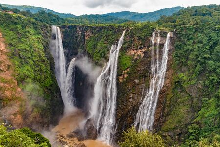 Beautiful view of very famous Jog Falls, Rocket Falls and Roarer Falls on Sharavathi River, in Western Ghats of Karnataka state in monsoon season. Entire South India is famous for such scenic beauty. Imagens