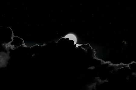 Amazing Night Scene with dramatic sky, full of Twinkling Stars and blurry Full moon glowing with full brightness behind the clouds, in rainy season of Monsoons. A Typical Horror Midnight Scene - Image Imagens