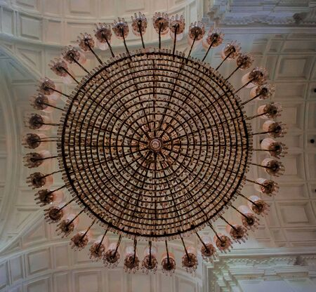 Perfect Baroque Architecture of church Roof with beautiful glass Chandelier. Shot taken from below the chandelier.