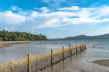Landscape of Coastal region with clear blue sky at a Tropical island where on beach, fencing has done from nets and beach seines, for swimmers safety to protect them from crocodiles and shark attacks. Imagens