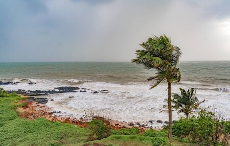 Climate change photo, taken during high speed cyclonic winds gushing through the coastal region, with heavy downpour taking place at horizon due to which it looks milky, and rain approaching coast. Stock Photo