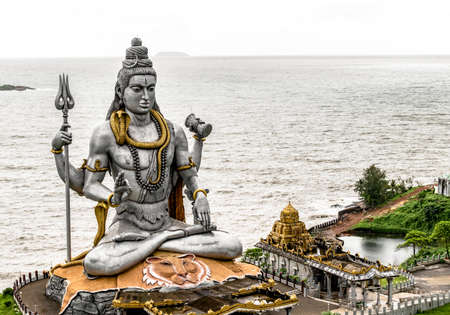 Very Famous and Magnificent statue of Lord Shiva in Murdeshwar, Karnataka. This 123 feet statue is situated on the coast of Arabian sea and is the second tallest statue of God Shiva of Hindu mythology Editorial