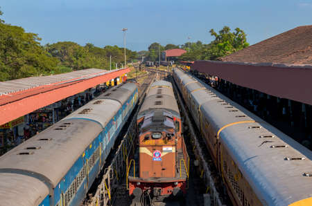 Trains of Indian railways, lined up at platform for passenger boarding and waiting for the green signal to depart at their scheduled time from Margao station.