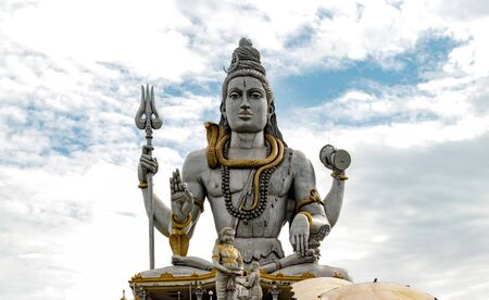 Very Famous and among the tallest Statue of Lord Shiva, meditating in Lotus Pose with Trident, drum in hand, snake around neck while giving blessings to His followers.