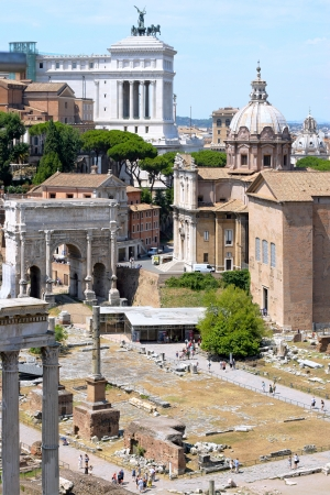 ROME - AUGUST 4   Ruins of the Roman Forum, church Santi Luca e Martina and Vittoriano on August 4, 2010 in Rome  There are three roman epochs at once on this photograph