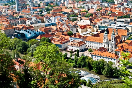 Aerial view of Graz, Austria with Kunsthaus Museum, the Grazer Murinsel and the Mariahilferkirche.