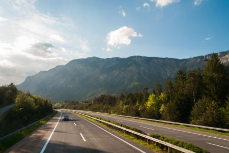 Autobahn in austrian mountains at sunset photo
