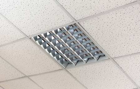 ceiling tile: Fluorescent lamp on the modern ceiling Stock Photo