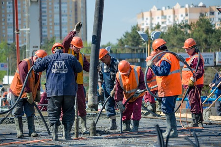 MOSCOW - MAY 2  Road workers concrete the superstructure of the bridge on May 2, 2014 in Moscow  The concrete placing technology used by the bridge builders ensures even distribution of the concrete and an ideal trestle slope