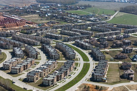 Aerial view of a modern suburban  townhouses near Novorigskaya highway in Russia photo