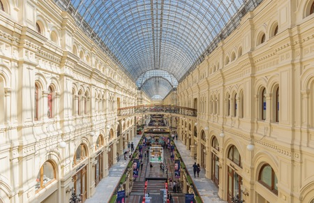 MOSCOW - MAY 18: Interior of the Main Universal Store (GUM) on May 18, 2014 in Moscow. Gosudarstvenny Universalny Magazin (GUM) (lit. - State Department Store), the large 3-story shopping center and great example of Russian architecture by Vladimir Shukho