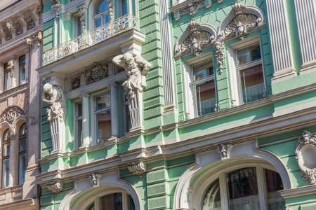 neoclassic: Beautiful neoclassic facade with atlants of the house on Iliynka street in Moscow old town, Russia