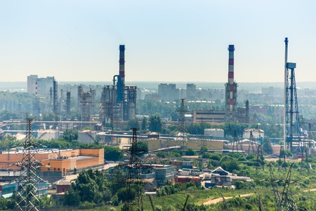 Extreme industry area with refinery, electric lines and residential buildings photo