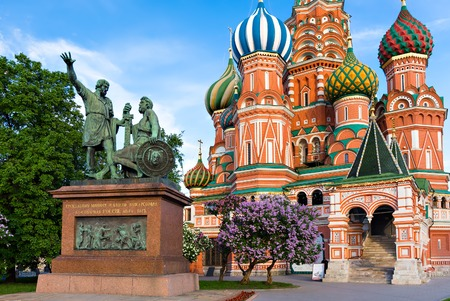 minin: MOSCOW - MAY 16: Statue of Kuzma Minin and Dmitry Pozharsky in front of St. Basil Cathedral on May 16, 2014 in Moscow. The cathedral was built between 1555 and 1561. The Minin and Pojarsky monument was erected in 1818.