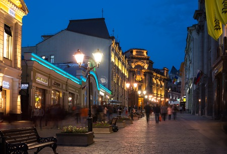 literally: MOSCOW - MAY 16: People walking down the Kuznetsky Most street on May 16, 2014 in Moscow. The name, literally Blacksmith