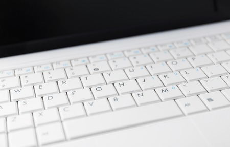 netbook: Closeup of the white netbook keyboard Stock Photo