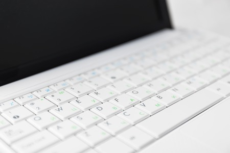 netbook: Closeup of the white netbook keyboard. With cyrillic symbols.