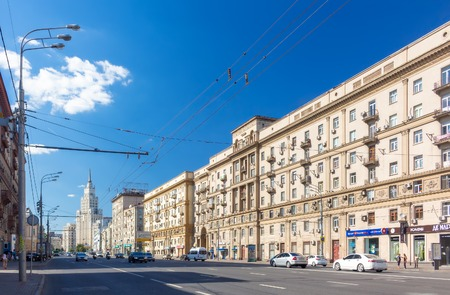 stalin empire style: MOSCOW - JULY 20: The Garden Ring and Red Gate Building on the background on July 20, 2014 in Moscow. The Garden Ring is a circular ring road avenue around the central Moscow, its course corresponding to what used to be the city ramparts surrounding Zemly