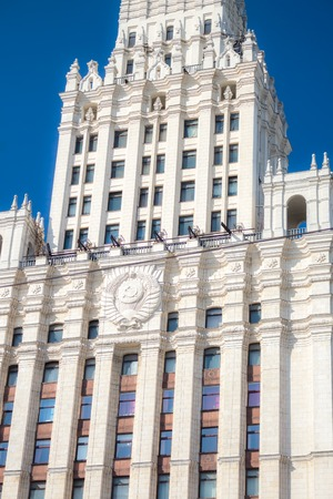 stalin empire style: Close up of the Soviet Union State Emblem on the Red Gate Building is one of seven Stalinist skyscrapers, designed by Alexey Dushkin. Its name comes from the Red Gate square. Editorial