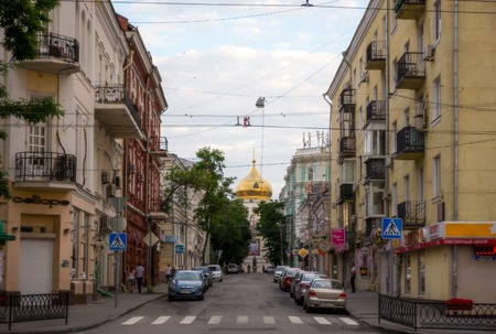 architectural feature: ROSTOV-ON-DON, RUSSIA - JUNE 14: People walking down Soborny side street on June 14, 2015 in Rostov-on-Don. The most conspicuous architectural feature of the central part of the city is the Cathedral of Virgins Nativity, designed by Konstantin Thon.