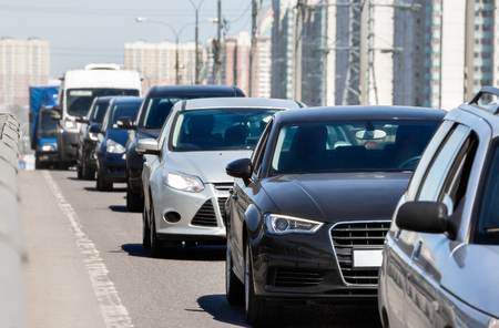 Generic cars standing in a queue during traffic jam Standard-Bild