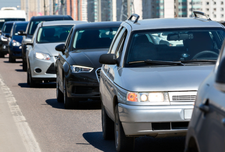 slow lane: Generic cars standing in a queue during traffic jam Stock Photo