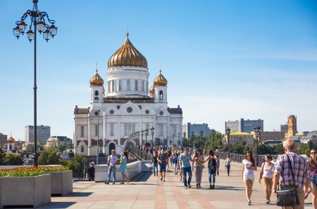 tallest bridge: MOSCOW - JULY 25: People walking on the Patriarshy Bridge near Cathedral of Christ the Savior on July 25, 2015 in Moscow. Cathedral of Christ the Savior with an overall height of 103 metres, it is the tallest Orthodox Christian church in the world.