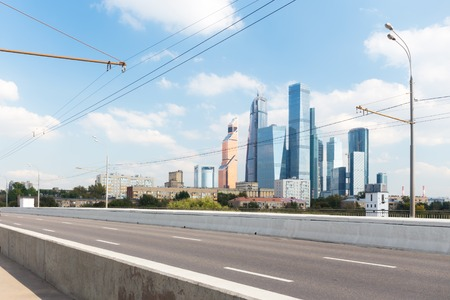 guardrails: Empty road and Moscow-City skyscrapers on the background