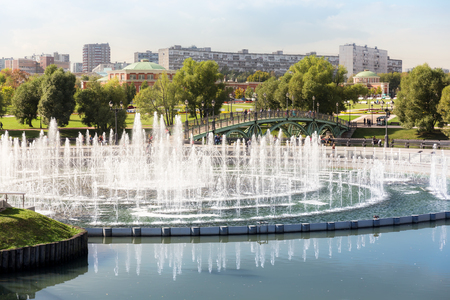 Fountain in Tsaritsyno park in Moscow with pedestrian bridge on the background