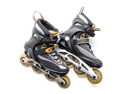 rollerskates: Pair of roller-skates on the white background. Stock Photo
