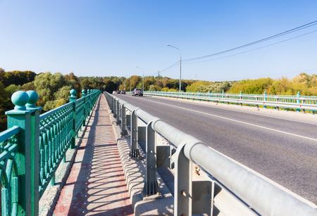 Fenced sidewalk on the bridge