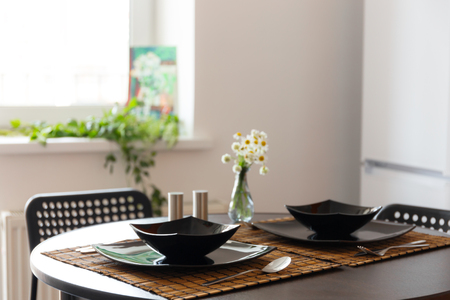 Table served with black dishes at daytime
