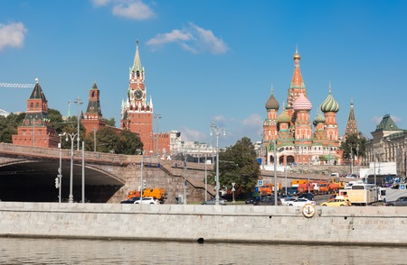 spasskaya: MOSCOW - SEPTEMBER 15, 2015: View from Raushskaya embankment to Spasskaya (Saviour) Tower  and St. Basils Cathedral. This place is one of the most visitable parts of the city. Editorial