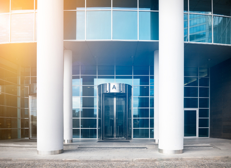 Entrance to a modern business center with sunflare effect Фото со стока - 64630864