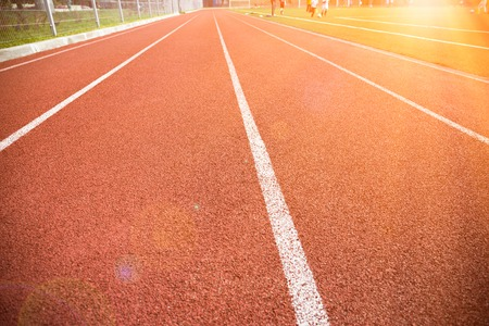 lanes: Lanes on a running track with sunlight Stock Photo
