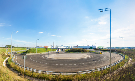 roundabout: Panoramic view of an empty roundabout. Stock Photo