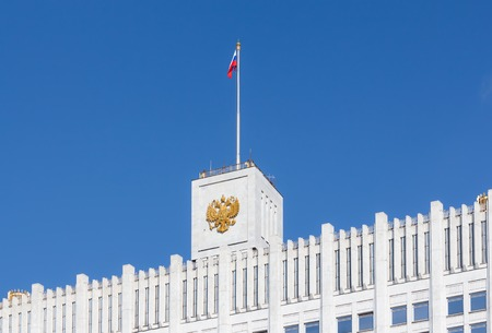 soviet flag: Fragment view of the Russian White House with flag and coat of arms